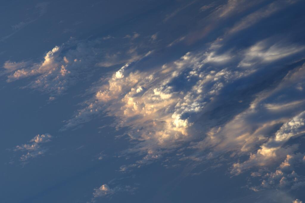"""""""#Clouds in the Pacific off the Brazilian coast, at sunset…#Volare"""" - Luca Parmitano"""