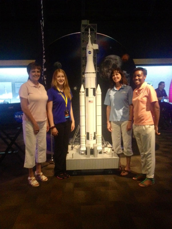 Here I am with ATK team members Jan, Kay and Nikki with a model SLS rocket...I really want one of these for my room! :)