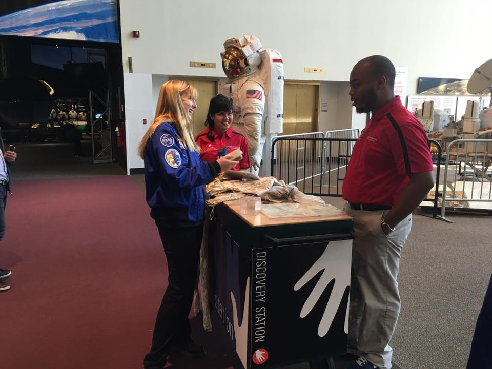 Another student Explainer shares his work at one of the National Air and Space Museum, Smithsonian Institution discovery stations. This station was featuring cooling suits astronauts wear!