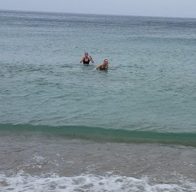 Taking advantage of the waves body surfing. Photo credit: Wellesley Baikal Research Team